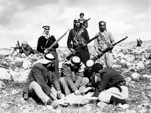 chalil rissas (khalil rassas), abd al-qadir al-husayni, studying maps with his aides, among them kassim al-rimawi (catalogued in the archive: ''arab gangs in jerusalem mountains''), 1948, haganah history archive. rissas's photographs from the haganah archive were looted from the photographer's studio by an israeli officer.