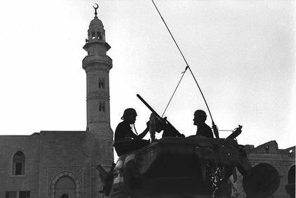 unknown photographer, gpo,  one of the israeli tanks in front of the mosque on the main square in bethlehem, june 1967